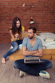 Serious Partners Using Laptop at Bed Room - PhotoDune Item for Sale