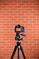 DSLR Camera on tripod shooting brick wall - PhotoDune Item for Sale