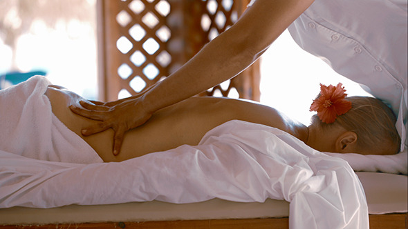 Woman Getting Body Massage At Beauty Spa