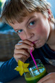 boy drinking green smoothie - PhotoDune Item for Sale