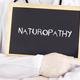 Doctor shows information on blackboard: naturopathy - PhotoDune Item for Sale