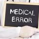 Doctor shows information on blackboard: medical error - PhotoDune Item for Sale