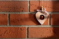 wooden heart hanging on brick wall - PhotoDune Item for Sale