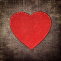 red leather heart on fabric in grunge style  - PhotoDune Item for Sale