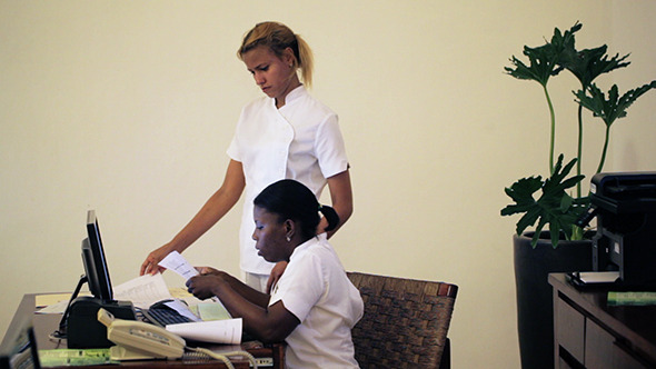 Two Women Receptionists Working At Beauty Spa