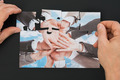 Person Hand Holding Jigsaw Puzzle - PhotoDune Item for Sale