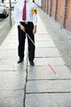 Blind Man Walking On Sidewalk - PhotoDune Item for Sale