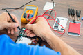 Technician Repairing Cellphone With Multimeter - PhotoDune Item for Sale
