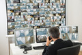 Security System Operator Looking At Cctv Footage - PhotoDune Item for Sale