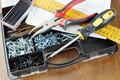 Pliers and screwdriver lie on a plastic organizer with many various screws - PhotoDune Item for Sale