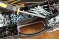 Screwdriver lies on a plastic box with many various screws - PhotoDune Item for Sale