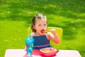 Toddler kid girl eating macaroni tomato pasta - PhotoDune Item for Sale