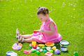 Toddler kid girl playing with food toys sitting in turf - PhotoDune Item for Sale