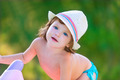 Baby kid girl with hat in summer on green field - PhotoDune Item for Sale