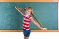 Braided student blond girl playing with braids - PhotoDune Item for Sale