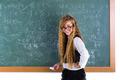 Nerd pupil blond girl in green board schoolgirl - PhotoDune Item for Sale