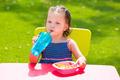 Toddler kid girl drinking eating pasta in garden - PhotoDune Item for Sale