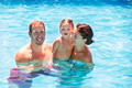 Happy family in swimming pool with baby girl - PhotoDune Item for Sale