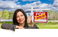 Hispanic Woman Leaning on White with Thumbs Up in Front of Beautiful House and Sold For Sale Sign - PhotoDune Item for Sale