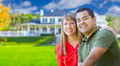Happy Mixed Race Couple in Front of Beautiful House. - PhotoDune Item for Sale