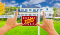 Female Hands Framing Sold Home For Sale Real Estate Sign in Front of New House. - PhotoDune Item for Sale