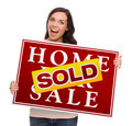 Happy Mixed Race Female with Sold Home For Sale Real Estate Sign Isolated on White. - PhotoDune Item for Sale