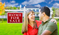 Happy Couple in Front of For Sale Real Estate Sign and New House. - PhotoDune Item for Sale
