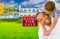 Happy Mixed Race Father and Son In Front of For Sale Real Estate Sign and New House. - PhotoDune Item for Sale