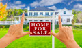 Female Hands Framing Home For Sale Real Estate Sign in Front of New House. - PhotoDune Item for Sale