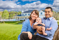 Happy Mixed Race Young Family in Front of Beautiful House. - PhotoDune Item for Sale