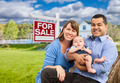Happy Young Mixed Race Family in Front of For Sale Real Estate Sign and New House. - PhotoDune Item for Sale
