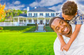 Happy Playful African American Father and Mixed Race Son In Front of House. - PhotoDune Item for Sale