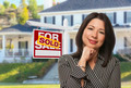 Proud, Attractive Hispanic Female Agent In Front of Sold For Sale Real Estate Sign and House. - PhotoDune Item for Sale