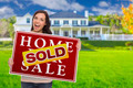 Excited Mixed Race Female with Sold Home For Sale Real Estate Sign In Front of Beautiful House. - PhotoDune Item for Sale