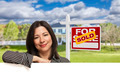 Hispanic Woman Leaning on White in Front of Beautiful House and Sold For Sale Sign - PhotoDune Item for Sale