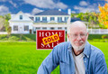 Senior Adult Man in Front of Sold Home For Sale Real Estate Sign and Beautiful House. - PhotoDune Item for Sale