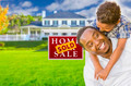 Happy Mixed Race Father and Son In Front of Sold Real Estate Sign and New House. - PhotoDune Item for Sale