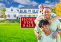 Happy African American Family In Front of For Sale Real Estate Sign and House. - PhotoDune Item for Sale