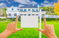 Female Hands Framing Home Blank Real Estate Sign in Front of New House. - PhotoDune Item for Sale