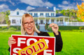 Excited Woman Holding House Keys and Sold Real Estate Sign in Front of Nice New Home. - PhotoDune Item for Sale