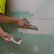 Construction Worker Applying Plaster on a Drywall - VideoHive Item for Sale