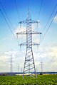 several transmission lines in the middle of a  field - PhotoDune Item for Sale
