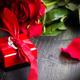 valentine's day Red roses and gift box on a wooden background - PhotoDune Item for Sale