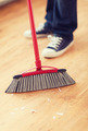 close up of male brooming wooden floor - PhotoDune Item for Sale