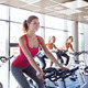 group of women riding on exercise bike in gym - PhotoDune Item for Sale