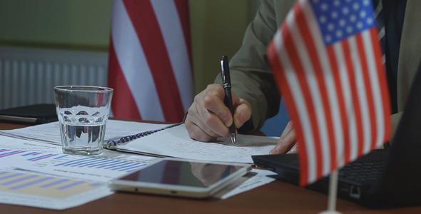 American Businessman Fills the Document