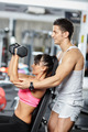 Personal trainer assisting young woman - PhotoDune Item for Sale