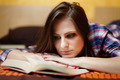 Woman reading a book on the bed - PhotoDune Item for Sale