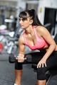 Girl doing biceps workout in a gym - PhotoDune Item for Sale