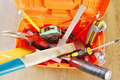 Plastic toolbox with various working tools. View from above - PhotoDune Item for Sale